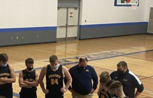Negaunee huddles up during a timeout against West Iron County.