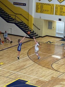 The Miners' Larissa Anderson closes out on Calumet shooter during Tuesday night's game.