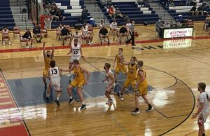 The Negaunee defense swarms a Westwood driver during Wednesday night's game.