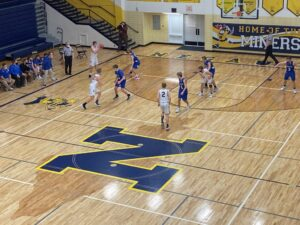 The Miners built a big lead in the third quarter, and won by 19 points over the Ishpeming Hematites.