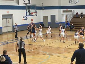 Alyssa Hill shoots for the Miners in the 40-33 win over West Iron.