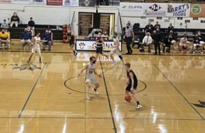 Negaunee's Mason Sager dribbles the ball across half court for the Miners.