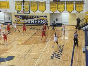 Negaunee's Morgan Carlson looks to pass the ball during the Miners' win.