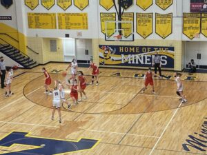 Lilly Nelson shoots a deep 3-pointer for the Miners. She had 14 points in Negaunee's 43-33 win.
