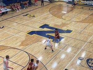 Mason Sager defends near half court against the Bulldogs during Negaunee's big win.