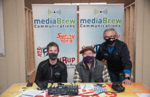Justin, Alex, and Chuck at the mediaBrew Communications booth