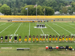 The national anthem is played throughout Mountaineer Stadium.
