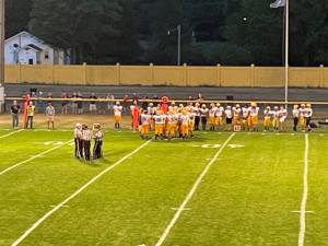 Negaunee huddles up on the sideline.