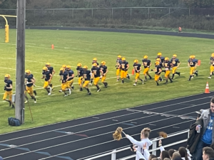 Negaunee rushes the field during warm ups