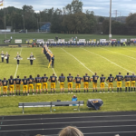 Negaunee marching band preforms at halftime