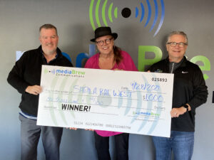 Sheila received her $1000 check this morning, presented by Mark Evans & Chuck Williams